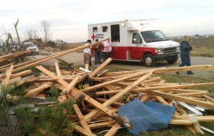 An American Red Cross emergency response vehicle pauses to provide hot food and coffee to those helping with the cleanup in Gifford, Ill., after a tornado tore through parts of the small town. The vehicle is driven by Ken and Ann Opatz of Lisbon, Iowa, who decided to become Red Cross volunteers after they retired so they could help people. (American Red Cross photo by Carl Manning)