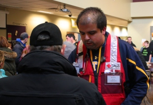 Daniel Luthi is a Red Cross volunteer and a registered nurse who talks to a resident of Washington, Ill, that was struck by tornado Nov. 17. Luthi said he enjoys using his medical skills to help his neighbors. (American Red Cross photo by Carl Manning)